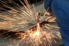 stock-footage-a-worker-in-factory-cutting-metal-using-blowtorch